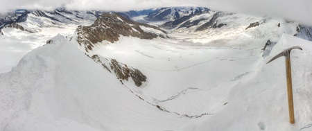 ice axe: Aerial view of alpine mountain panorama over Aletsch glacier and surrounding mountain range with ice pick seen from top of 4,099 m high mount Moench Stock Photo
