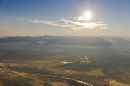foothill: view over the border plain of Switzerland and Liechtenstein in morning mist veil with river Rhine