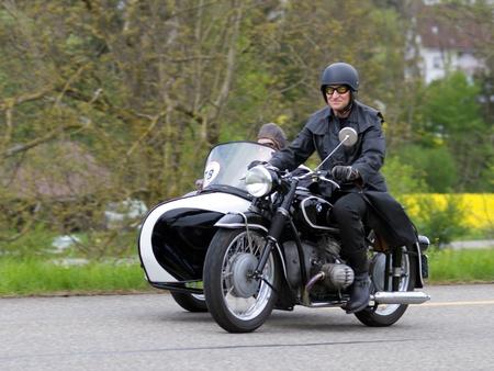 mutschellen: MUTSCHELLEN, SWITZERLAND-APRIL 29: Vintage sidecar motorbike BMW R 51 3 from 1954 at Grand Prix in Mutschellen, SUI on April 29, 2012.  Invited were vintage sports cars and motorbikes. Editorial