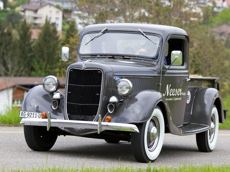 MUTSCHELLEN, SWITZERLAND-APRIL 29: Vintage pre war  car Ford Pick-up from  1936 at Grand Prix in Mutschellen, SUI on April 29, 2012.  Invited were vintage sports cars and motorbikes. Stock Photo - 13491358