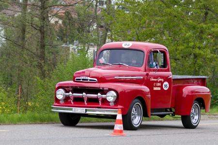 sui: MUTSCHELLEN, SWITZERLAND-APRIL 29: Vintage car Ford F 100 Pick-up from 1951 at Grand Prix in Mutschellen, SUI on April 29, 2012.  Invited were vintage sports cars and motorbikes. Editorial