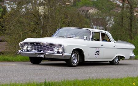 mutschellen: MUTSCHELLEN, SWITZERLAND-APRIL 29: Vintage car Dodge Dart V8 Pioneer from 1961 at Grand Prix in Mutschellen, SUI on April 29, 2012.  Invited were vintage sports cars and motorbikes. Editorial