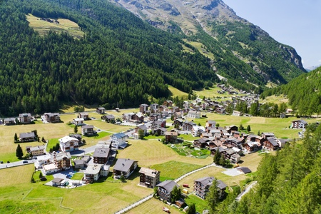 small swiss village settlement in green deept wooded valley  in canton Valais  Switzerland