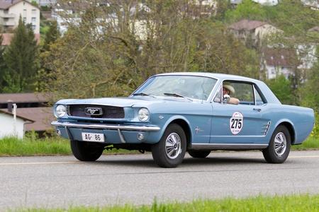 mutschellen: MUTSCHELLEN, SWITZERLAND-APRIL 29: Vintage car Ford Mustang from 1965 at Grand Prix in Mutschellen, SUI on April 29, 2012.  Invited were vintage sports cars and motorbikes.