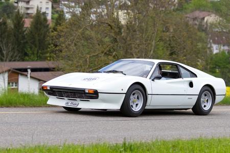 mutschellen: MUTSCHELLEN, SWITZERLAND-APRIL 29: Vintage  car Ferrari 308 GTB from  1977 at Grand Prix in Mutschellen, SUI on April 29, 2012.  Invited were vintage sports cars and motorbikes.