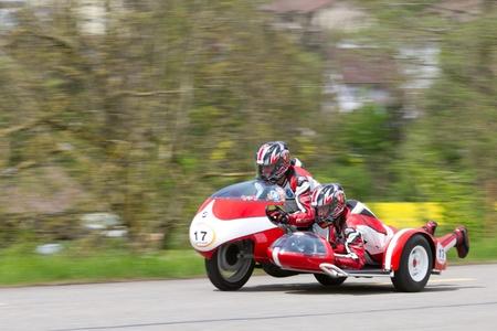 MUTSCHELLEN, SWITZERLAND-APRIL 29: Vintage sidecar motorbike BMW Kneeler  from 1962 at Grand Prix in Mutschellen, SUI on April 29, 2012.  Invited were vintage sports cars and motorbikes. Stock Photo - 13575551