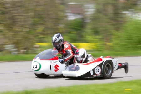 str: MUTSCHELLEN, SWITZERLAND-APRIL 29: Vintage sidecar motorbike STR Suzuki Kneeler T 500  from 1979 at Grand Prix in Mutschellen, SUI on April 29, 2012.  Invited were vintage sports cars and motorbikes.