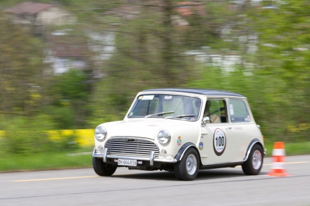 sui: MUTSCHELLEN, SWITZERLAND-APRIL 29: Vintage race touring car Morris Mini Cooper S from 1969 at Grand Prix in Mutschellen, SUI on April 29, 2012.  Invited were vintage sports cars and motorbikes.