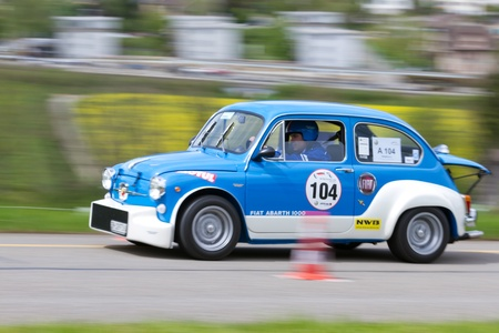 sui: MUTSCHELLEN, SWITZERLAND-APRIL 29: Vintage race touring car Fiat 600 Abarth 1000 TC from  1967 at Grand Prix in Mutschellen, SUI on April 29, 2012.  Invited were vintage sports cars and motorbikes.