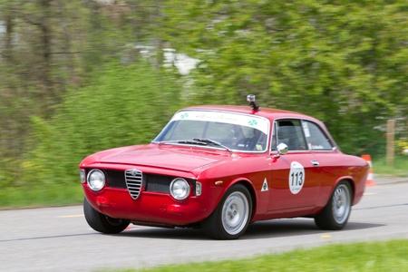 mutschellen: MUTSCHELLEN, SWITZERLAND-APRIL 29: Vintage race touring car Alfa Romeo Giulia Sprint GT Veloce from  1966 at Grand Prix in Mutschellen, SUI on April 29, 2012.