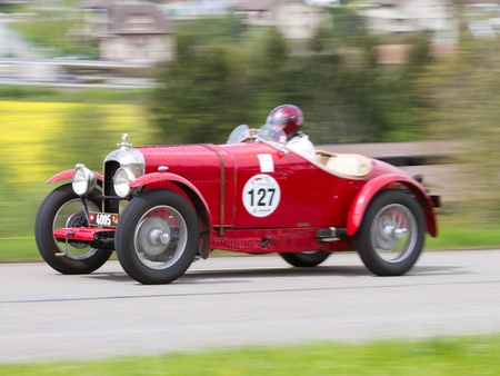 sui: MUTSCHELLEN, SWITZERLAND-APRIL 29: Vintage pre war race car Amilcar CG SS from  1926 at Grand Prix in Mutschellen, SUI on April 29, 2012.  Invited were vintage sports cars and motorbikes.
