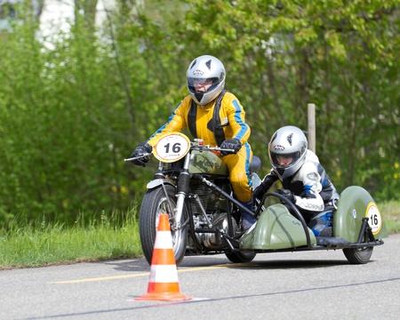 mutschellen: MUTSCHELLEN, SWITZERLAND-APRIL 29: Vintage sidecar motorbike Velox BSA WM 20 from 1952 at Grand Prix in Mutschellen, SUI on April 29, 2012.  Invited were vintage sports cars and motorbikes.
