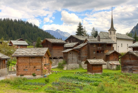 small swiss village settlement Blatten Naters of withered wooden houses and church  in canton Valais  Switzerland