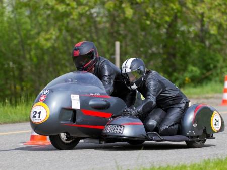 mutschellen: MUTSCHELLEN, SWITZERLAND-APRIL 29: Vintage sidecar motorbike BMW Kneeler from 1968 at Grand Prix in Mutschellen, SUI on April 29, 2012.  Invited were vintage sports cars and motorbikes. Editorial
