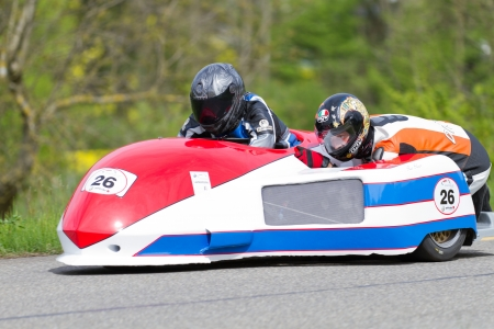 antique tricycle: MUTSCHELLEN, SWITZERLAND-APRIL 29: Vintage sidecar motorbike Fl�ckigerGraf FRG 500 from 1981 at Grand Prix in Mutschellen, SUI on April 29, 2012.  Invited were vintage sports cars and motorbikes. Editorial