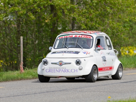 MUTSCHELLEN, SWITZERLAND-APRIL 29: Vintage race touring car Fiat Abarth 595 from 1965 at Grand Prix in Mutschellen, SUI on April 29, 2012.  Invited were vintage sports cars and motorbikes.