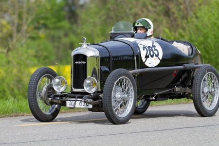 invited: MUTSCHELLEN, SWITZERLAND-APRIL 29: Vintage pre war race car Amilcar CG SS from  1926 at Grand Prix in Mutschellen, SUI on April 29, 2012.  Invited were vintage sports cars and motorbikes.