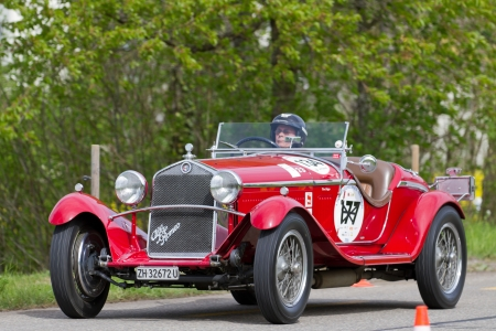 sui: MUTSCHELLEN, SWITZERLAND-APRIL 29: Vintage pre war race car Alfa Romeo Grand Sport from  1931 at Grand Prix in Mutschellen, SUI on April 29, 2012.  Invited were vintage sports cars and motorbikes.