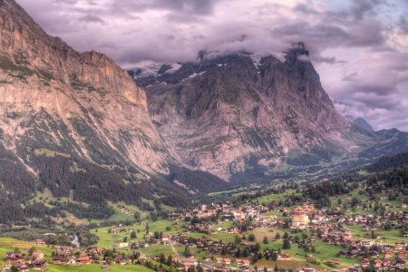 Famous alpine town Grindelwald in valley at sunset in front of mountain Eiger north face, Switzerland Stock Photo - 13696403