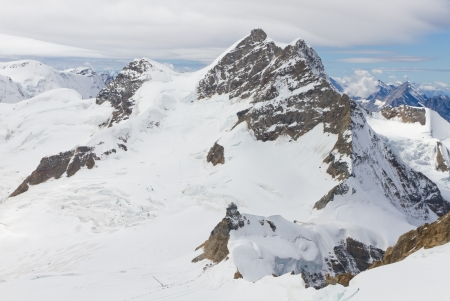 snow and ice crusted  top of 4,158 m high mountain Jungfrau, Bernese alps Switzerland with mountain station Sphinx, seen from Jungfraujoch Stock Photo - 13696363