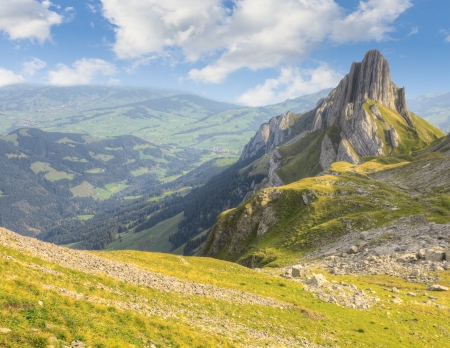 hiking path through rocky mountainous terrain with sharp rock formations in the background, Switzerland