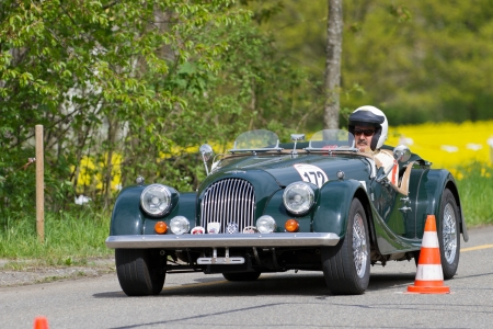 sui: MUTSCHELLEN, SWITZERLAND-APRIL 29: Vintage race touring car Morgan at Grand Prix in Mutschellen, SUI on April 29, 2012.  Invited were vintage sports cars and motorbikes. Editorial