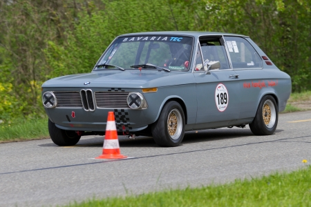 MUTSCHELLEN, SWITZERLAND-APRIL 29: Vintage race touring car BMW 2002 touring from 1972 at Grand Prix in Mutschellen, SUI on April 29, 2012.  Invited were vintage sports cars and motorbikes.