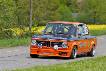 motorcar: MUTSCHELLEN, SWITZERLAND-APRIL 29: Vintage race touring car BMW 2002 Tii from 1974 at Grand Prix in Mutschellen, SUI on April 29, 2012.  Invited were vintage sports cars and motorbikes.