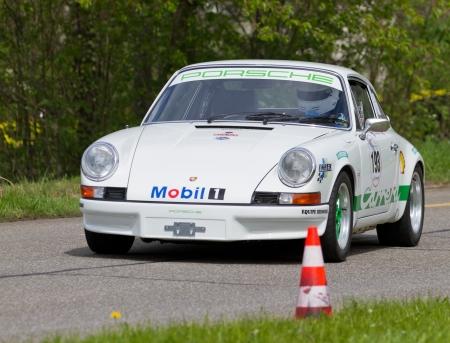 mutschellen: MUTSCHELLEN, SWITZERLAND-APRIL 29: Vintage race touring car Porsche 2.4S from 1972 at Grand Prix in Mutschellen, SUI on April 29, 2012.  Invited were vintage sports cars and motorbikes. Editorial