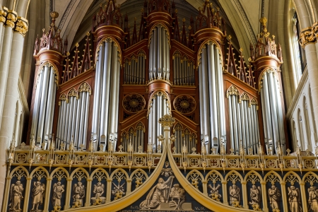 organ: Vintage pipe organ in Cathedral  St.Nicholas  Fribourg, Switzerland Editorial