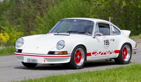 mutschellen: MUTSCHELLEN, SWITZERLAND-APRIL 29: Vintage race touring car Porsche Carrera RS 2.7 from 1973 at Grand Prix in Mutschellen, SUI on April 29, 2012.  Invited were vintage sports cars and motorbikes.