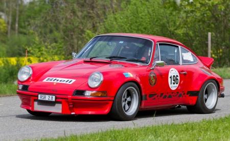 mutschellen: MUTSCHELLEN, SWITZERLAND-APRIL 29: Vintage race touring car Porsche Carrera RSR 2.8 from 1973 at Grand Prix in Mutschellen, SUI on April 29, 2012.  Invited were vintage sports cars and motorbikes.