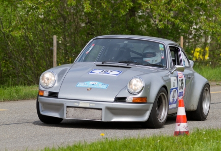 sui: MUTSCHELLEN, SWITZERLAND-APRIL 29: Vintage race touring car Porsche RSR from 1973 at Grand Prix in Mutschellen, SUI on April 29, 2012.  Invited were vintage sports cars and motorbikes. Editorial