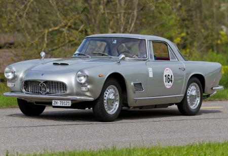 sui: MUTSCHELLEN, SWITZERLAND-APRIL 29: Vintage race touring carMaserati 3500 GT from 1962 at Grand Prix in Mutschellen, SUI on April 29, 2012.  Invited were vintage sports cars and motorbikes.