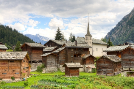 small swiss village settlement Blatten Naters of withered wooden houses and church  in canton Valais  Switzerland  photo