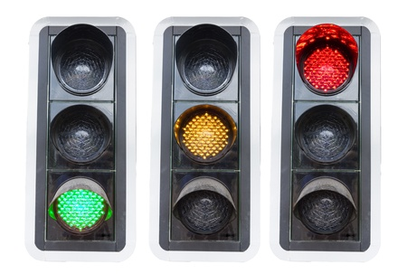 city lights: traffic lights showing red green and red isolated on white concepts for go and stopp and structure chaos