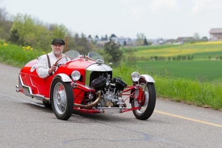 mutschellen: MUTSCHELLEN, SWITZERLAND-APRIL 29: Vintage tricycle race car Morgan Super Sport from 1933 at Grand Prix in Mutschellen, SUI on April 29, 2012.  Invited were vintage sports cars and motorbikes.