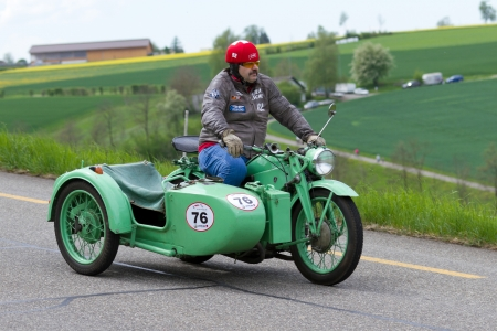 sui: MUTSCHELLEN, SWITZERLAND-APRIL 29: Vintage sidecar motorbike Z�ndapp KS 600 from 1941 at Grand Prix in Mutschellen, SUI on April 29, 2012.  Invited were vintage sports cars and motorbikes.