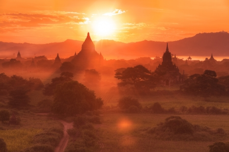 sunset panorama of many Bagan temples and rice fields, Burma photo