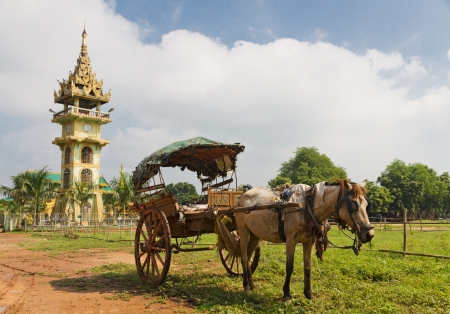 horse cart: tradiitional burmese horse cart with wooden wheels used for transport and to cart around tourists in front of Paleik snake temple, Burma