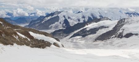 aletsch: Aerial view of alpine mountain panorama surrounding Aletsch glacier  seen from Jungfraujoch, Switzerland