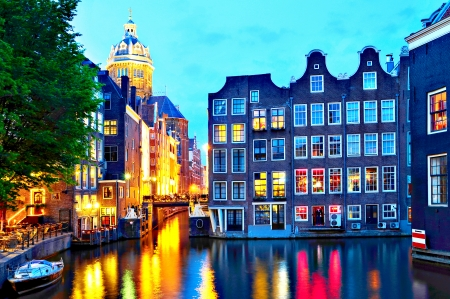 Amsterdam  St  Nicolas Church and Canals at dusk   photo