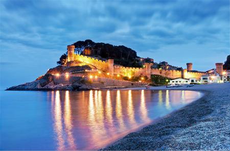 Tossa de mar, costa brava, fortress with beach at dusk