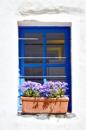 Window and flowers at ciosta brava, spain