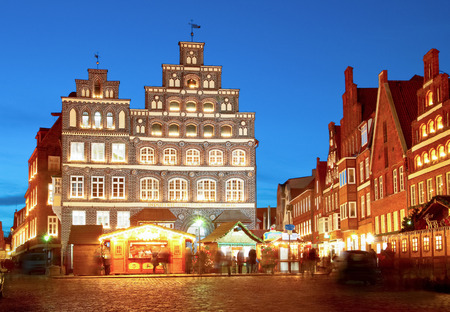 Lueneburg, Germany  Old, famous chamber of industry and commerce at night with christmass-market