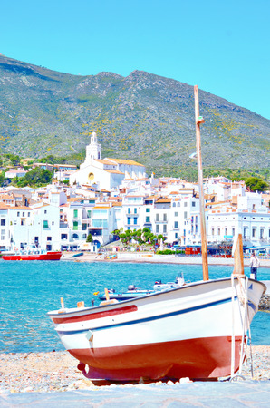 cadaqes, costa brava, spain  cathedral, old town and fishing boats Stock Photo