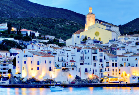 beaches of spain: Cadaqeus, Costa brava, Spain  cathedral and Old Town with sailing boat