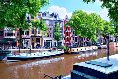 Typical Scenery with Houseboats and Canal in Amsterdam, Netherlands