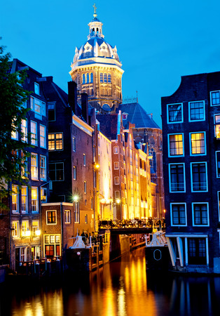 Amsterdam  St  Nicolas Church and Canals at dusk