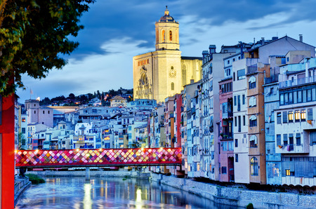 Girona, Spain with decorated Bridge Girona, Spain with decorated Bridge in the evening  Flower Festival 2013    photo